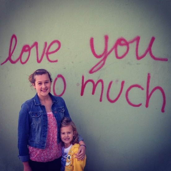 """Aaron's daughters (oldest and youngest) in front of the """"I Love You"""" wall in Austin. They both LOVE music and are an inspiration to Aaron. Photo: Aaron Strout"""